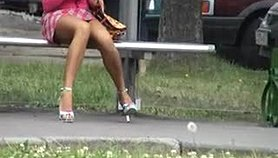 Delicious brunette waits for the bus while getting caught o