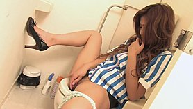 Horny babe pulls off her panties on the toilet to masturbate
