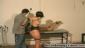 Two submissive girls are getting tied and spanked by dominant guy