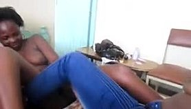 Relaxed African babes toy their slippery pussies on bed